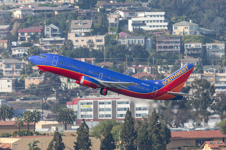 San Diego, California, USA - April 28, 2013. Southwest Airlines Boeing 737-3H4 N323SW departing San Diego International Airport.