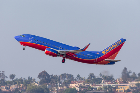 San Diego, California, USA - April 30, 2013. Southwest Airlines Boeing 737-7H4 N908WN departing San Diego International Airport.