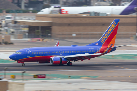 San Diego, California, USA - April 30, 2013. Southwest Airlines Boeing 737-7H4 N247WN arriving at San Diego International Airport.