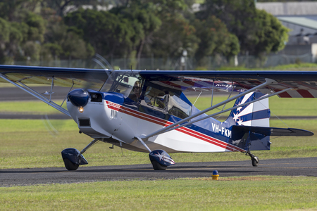 Albion Park, Australia - May 4, 2014: American Champion 8KCAB single engine light aircraft VH-FKM at Illawarra Regional Airport.