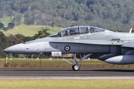 Albion Park, Australia - May 4, 2014: Royal Australian Air Force (RAAF) McDonnell Douglas FA-18B Hornet jet aircraft A21-110 at Illawarra Regional Airport, Albion Park.