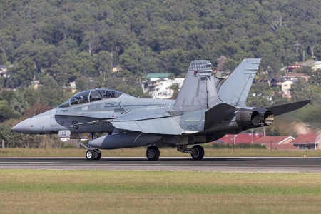 Albion Park, Australia - May 4, 2014: Royal Australian Air Force (RAAF) McDonnell Douglas FA-18B Hornet jet aircraft A21-112 at Illawarra Regional Airport, Albion Park.