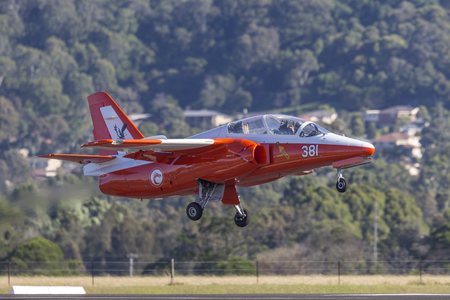 Albion Park, Australia - May 4, 2014: Siai Marchetti S.211 jet VH-DZJ in the markings of the Republic of Singapore Air Force taking off from Illawarra Regional Airport, Albion park. 報道画像