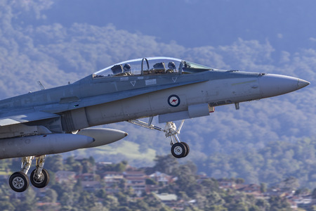 Albion Park, Australia - May 4, 2014: Royal Australian Air Force (RAAF) McDonnell Douglas FA-18B Hornet jet taking off from Illawarra Regional Airport.