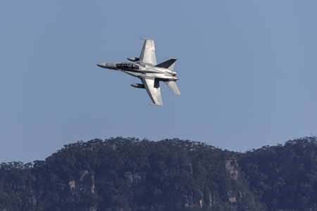 Albion Park, Australia - May 4, 2014: Royal Australian Air Force (RAAF) McDonnell Douglas FA-18B Hornet jet aircraft A21-110 flying.