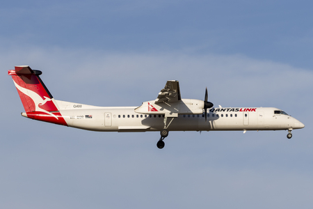 Melbourne, Australia - November 8, 2014: QantasLink De Havilland Canada DHC-8-402Q VH-QOR regional airliner on approach to land at Melbourne International Airport.
