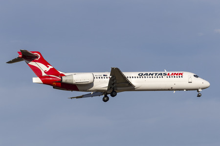 Melbourne, Australia - November 8, 2014: QantasLink Boeing 717-2BL aircraft VH-YQT on approach to Melbourne International Airport. Editorial