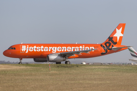 Melbourne, Australia - November 8, 2014: Jetstar Airways Airbus A320 VH-VGT at Melbourne International Airport in a bright orange #jetstargeneration livery. Editorial