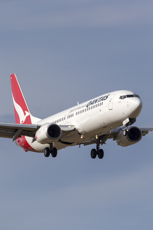 Melbourne, Australia - November 8, 2014: Qantas Boeing 737-838 Airliner VH-VZD on approach to land at Melbourne International Airport.
