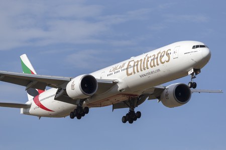 Melbourne, Australia - November 8, 2014: Emirates Boeing 777-300 airliner A6-ECQ  on approach to land at Melbourne International Airport. Sajtókép