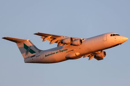 Adelaide, Australia - January 7, 2013: Australian Air Express (National Jet Systems) British Aerospace 146-300 aircraft VH-NJF taking off from Adelaide Airport at sunset.