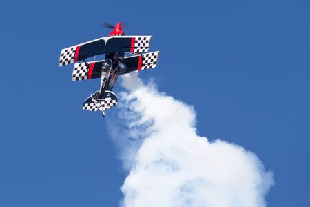 Avalon, Australia - March 3, 2013: Skip Stewart flying his highly modified Pitts S-2S biplane Prometheus