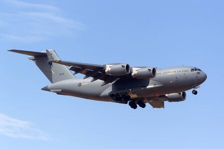 Avalon, Australia - February 25, 2013: Royal Australian Air Force (RAAF) Boeing C-17A Globemaster III Large military cargo aircraft A41-211 from 36 Squadron based at RAAF Amberley, Queensland.