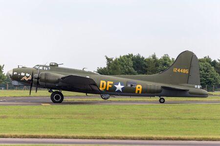RAF Waddington, Lincolnshire, UK - July 5, 2014: World War II era Boeing B-17 Flying Fortress bomber aircraft 'Sally B' (G-BEDF). 報道画像