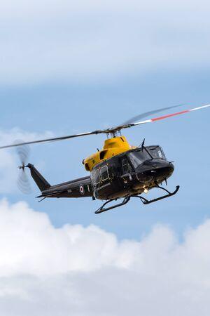 RAF Waddington, Lincolnshire, UK - July 7, 2014: Royal Air Force (RAF) Bell 412EP Griffin HT.1 Helicopter ZJ235 at RAF station Waddington. Editorial