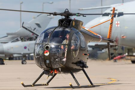 RAF Waddington, Lincolnshire, UK - July 7, 2014: Former United States Army Hughes OH-6A Cayuse (69-16011) military helicopter G-OHGA.