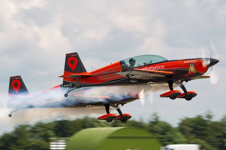 RAF Waddington, Lincolnshire, UK - July 5, 2014: The Blades formation aerobatic team flying Extra EA-300L aerobatic aircraft at the RAF Waddington Airshow.