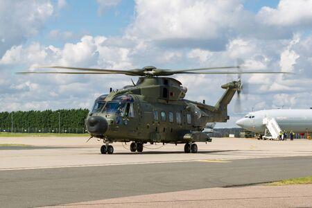 RAF Waddington, Lincolnshire, UK - July 5, 2014: Royal Air Force (RAF) AgustaWestland Merlin HC3 (EH-101) ZK001 medium lift utility helicopter. Editöryel