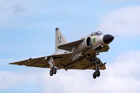 RAF Waddington, Lincolnshire, UK - July 6, 2014: Swedish Air Force Historic Flight Saab AJS-37 Viggen fighter aircraft SE-DXN.