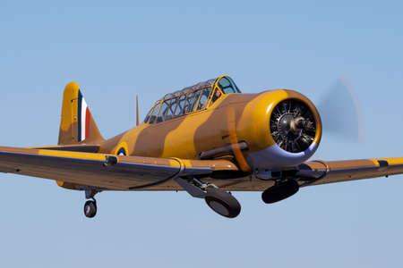 Tyabb, Australia - March 9, 2014: North American T-6 (Noorduyn AT-16) Harvard VH-TXN single engine military training aircraft from World War II.