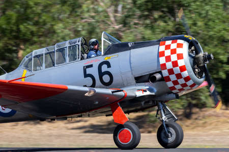 Tyabb, Australia - March 9, 2014: Former Royal New Zealand Air Force (RNZAF) North American AT-6C Harvard VH-NAH single engine military training aircraft from World War II. Editorial