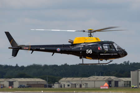 RAF Fairford, Gloucestershire, UK - July 9, 2014: Royal Air Force (RAF) Eurocopter AS-350BB Squirrel HT.1 helicopter ZJ256 from the Defence Helicopter Flying School at RAF Shawbury.