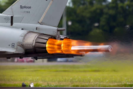 RAF Fairford, Gloucestershire, UK - July 14, 2014: Glowing hot afterburners of Italian Air Force Eurofighter Typhoon aircraft as it accelerates down the runway.