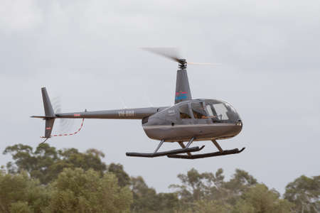 Rowland Flat, Australia - April 14, 2013: Robinson R-44 Raven II helicopter VH-BBR operated by Barossa Helicopters.