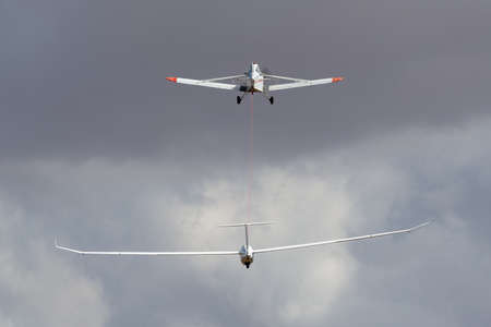 Rowland Flat, Australia - April 14, 2013: Piper PA-25 Pawnee aircraft VH-BOT towing a glider into the sky. Editorial
