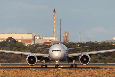 Sydney, Australia - October 8, 2013: Emirates Boeing 777 aircraft on the tarmac after landing at Sydney Airport. 報道画像