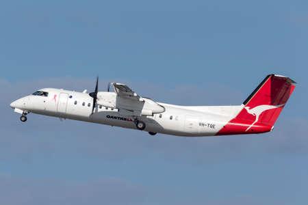 Sydney, Australia - October 7, 2013: QantasLink (Eastern Australia Airlines) de Havilland Canada Dash 8 twin engine turboprop regional airliner aircraft taking off from Sydney Airport. Editorial