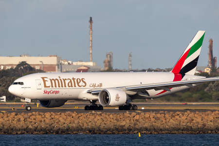Sydney, Australia - October 7, 2013: Emirates Cargo Boeing 777 cargo aircraft on the tarmac after landing at Sydney Airport. 報道画像