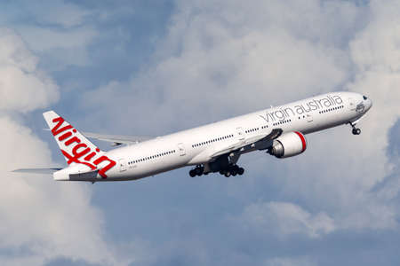 Sydney, Australia - October 8, 2013: Virgin Australia Airlines Boeing 777-300 large commercial airliner aircraft taking off from Sydney Airport. Editorial