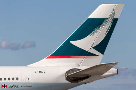 Melbourne, Australia - June 23, 2015: Tail of Cathay Pacific Airways Airbus A330 airliner aircraft B-HLS showing Cathay Pacific Logo.