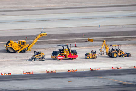 Las Vegas, Nevada, USA - May 5, 2013: Contruction equipment and machinery lined up at McCarran International Airport during construction works on the runway.