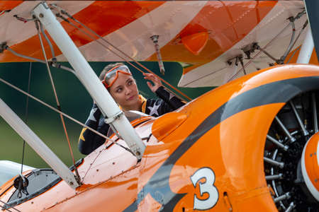 Payerne, Switzerland - August 31, 2014: Breitling Wing walker Danielle Hughes preparing for a flying display on a vintage Boeing Stearman. 報道画像