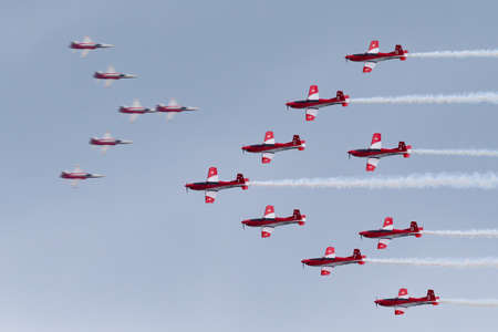 Payerne, Switzerland - September 1, 2014: Swiss Air Force PC-7 display team flying Pilatus PC-7 trainer aircraft.