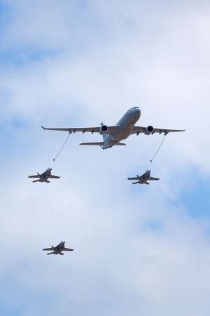 Avalon, Australia - February 25, 2015: Royal Australian Air Force (RAAF) Airbus KC-30A Multi Role Tanker Transport Aircraft from RAAF Amberley refueling three Boeing F/A-18F Super hornet multirole fighter aircraft.
