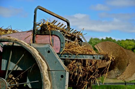 An old manure spreader is loaded and ready to be hauled to the field