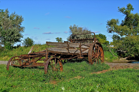 rickety: Old rickety manure spreader in the field