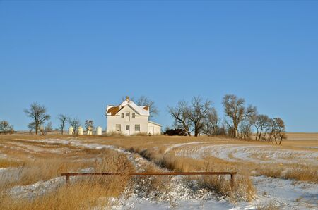 Rural country home abandoned in the prairie photo