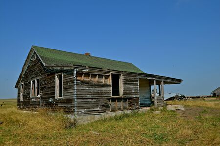 ranch house: Rickety old weathered abandoned Ranch House Stock Photo