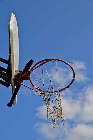 backboard: Tattered Outdoor Basketball Net and Backboard