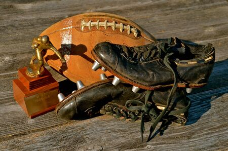 pigskin: Old Football Memories with a trophy, shoes and an old pigskin