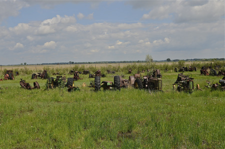 junky: Old worn-out tractors parked in a junkyard for salvage and parts Stock Photo