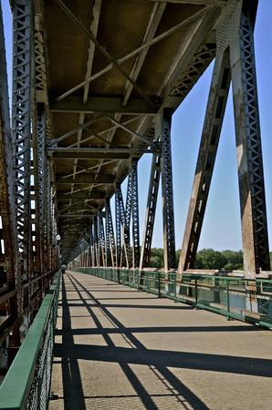 tier: Steel two tier bridge over a river