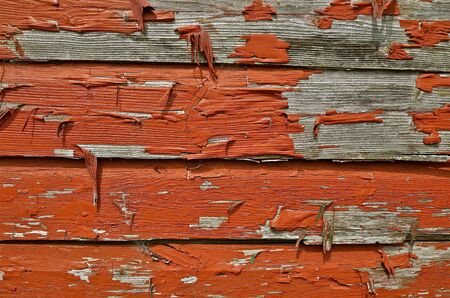 Peeling red paint photo