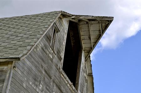 haymow: Hay loft barn door open with peak and much weathered wood