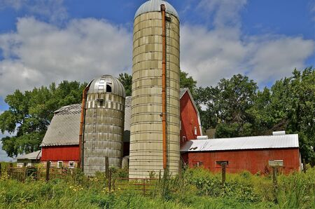 cows red barn: Huge silos and barn of an inactive former dairy operation