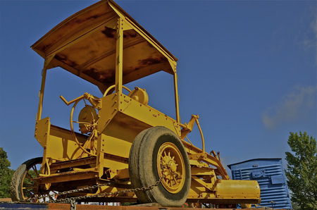 grader: An antique road grader is secured to the flatbed of a freight train